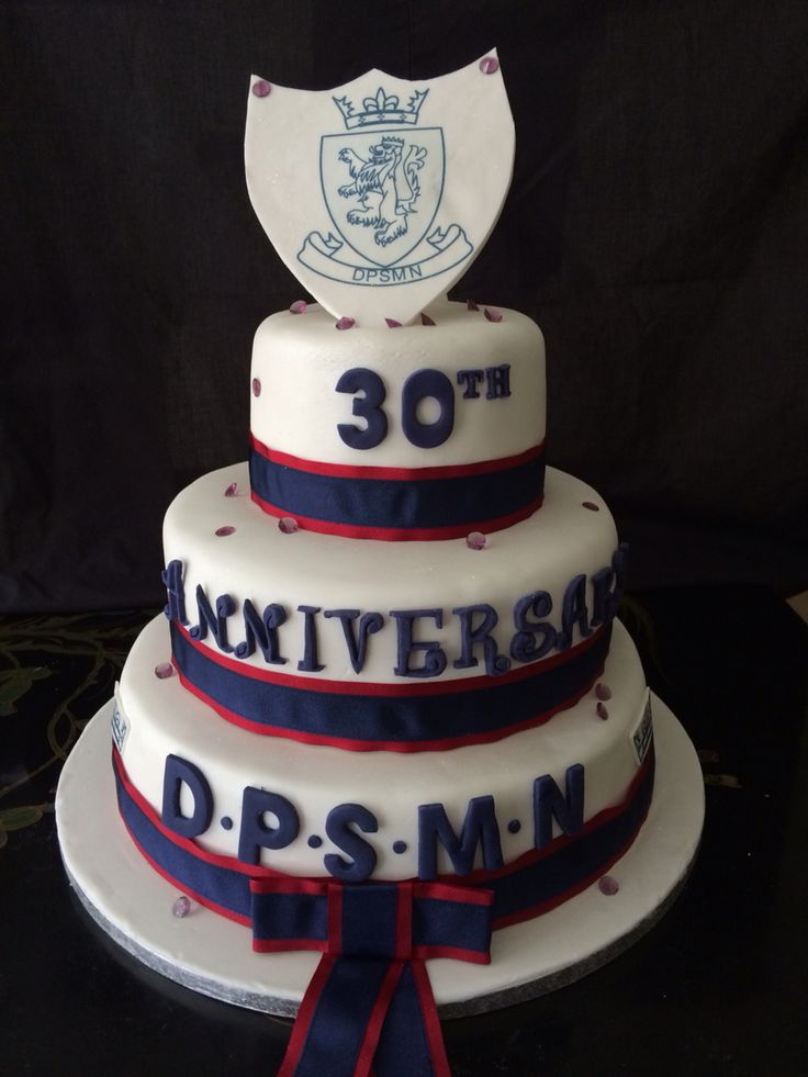Anniversary cake for a school with the school colours and shield