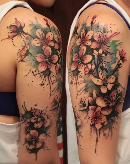 I love this style.Realistic yet soft, and the paint splatter effect is very me.Gene Coffey - Blossom Half Sleeve Color Tattoo