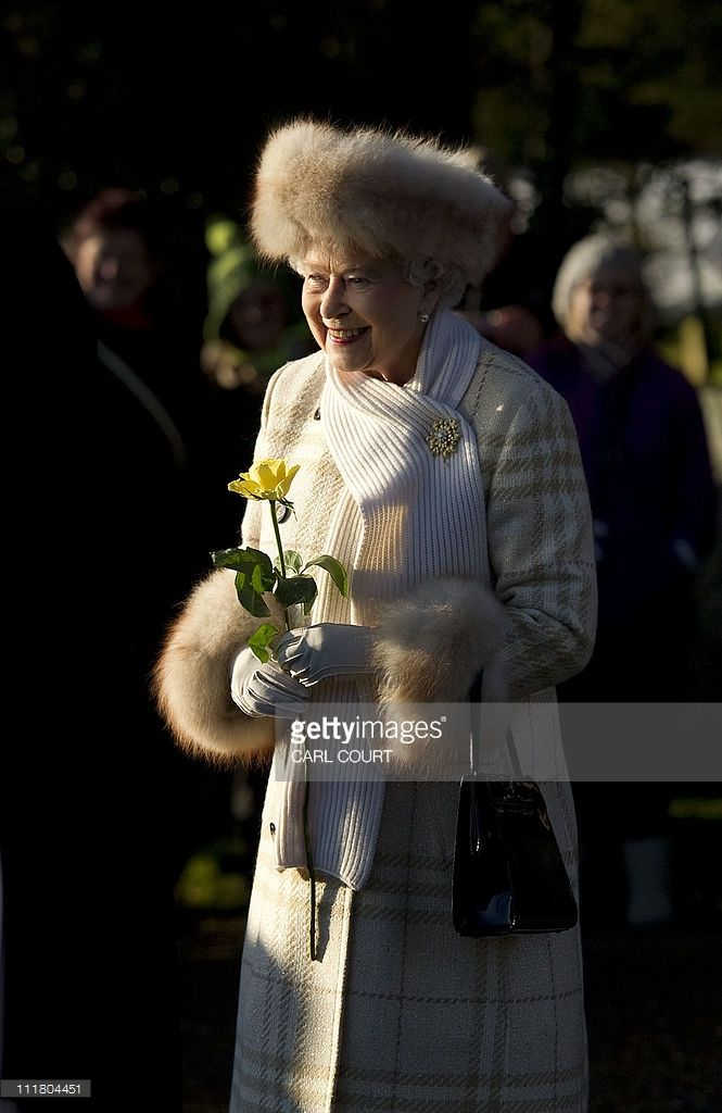 Queen Elizabeth II leaves after attending a Christmas Day church service at St Mary Magdalene Church in Sandringham, Norfolk, in the east of England, on December 25, 2010.AFP PHOTO /CARL COURT (Photo credit should read CARL COURT/AFP/Getty Images)