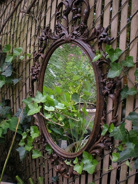 A second-hand mirror can add lovely interest and dimension in your garden