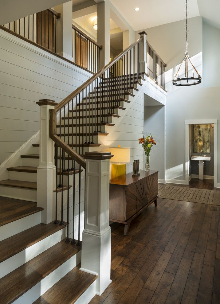 Entryway with rustic wood floors, L-shaped stairway, shiplap wall, rustic…