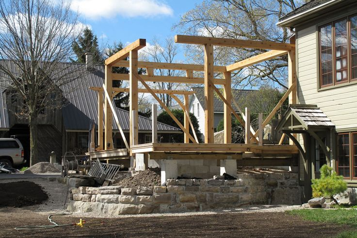The next spring begins with a cedar timber-frame structure being assembled.