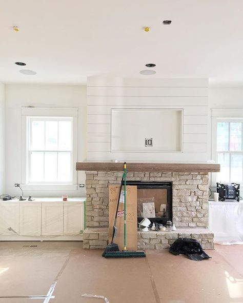 White Brick Fireplace With Wood Mantle And Tv