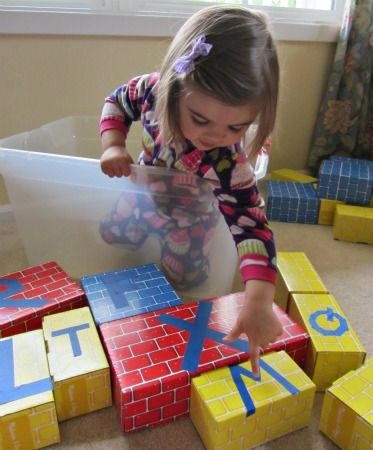 Build with letters;alphabet for starters: Cardboard boxes with tape letters
