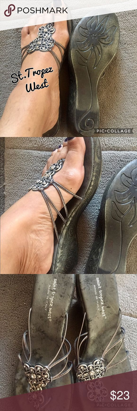 St. Tropez West Silver Pewter Sandals St. Tropez West Silver Pewter Sandals. Sandals have bling ornament center of foot holding 4 tiny straps on shoe. Have scalloped wedge sides. Wedge heel 2 inches. In excellent condition St. Tropez Shoes Sandals