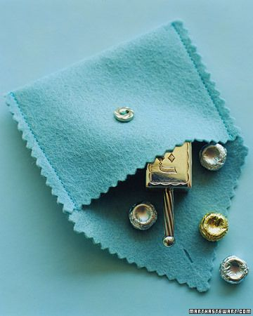 Felt Dreidel  Within a small felt pouch or coin purse, nestle a silver dreidel and some foil-wrapped sweets.  How to Make the Felt Dreidel