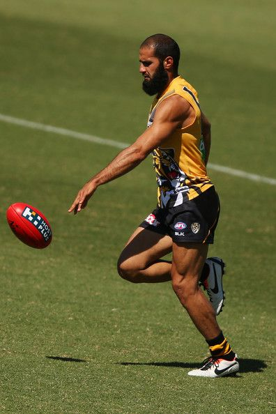 Bachar Houli bounces the ball during a Richmond Tigers AFL training session at ME Bank Centre on March 25, 2014 in Melbourne, Australia.