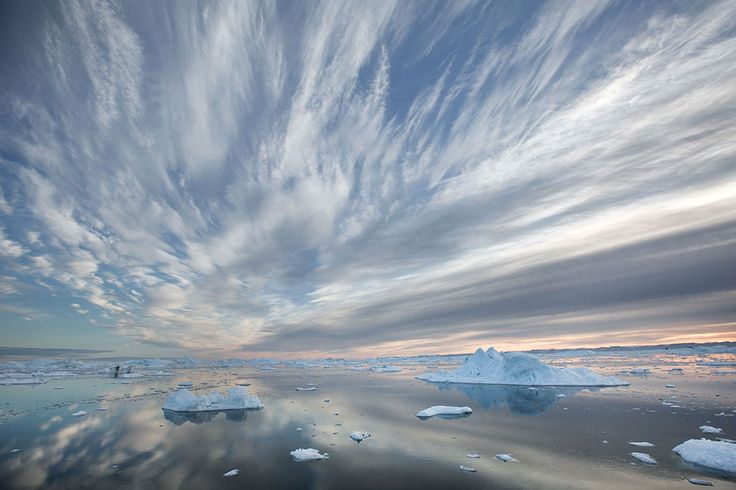 Greenland | Lawrence Hislop Photography. Sky, clouds and ice filled water in Ilulissat, Greenland.