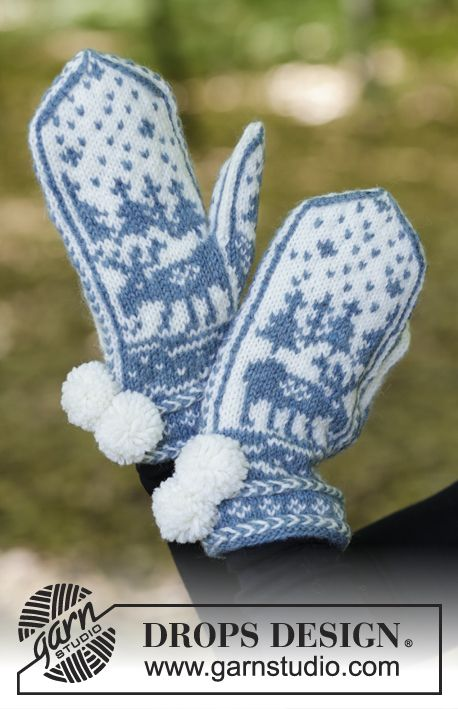 Knitted mittens with multi-coloured Nordic pattern and Latvian cable. The piece is worked in DROPS Karisma.