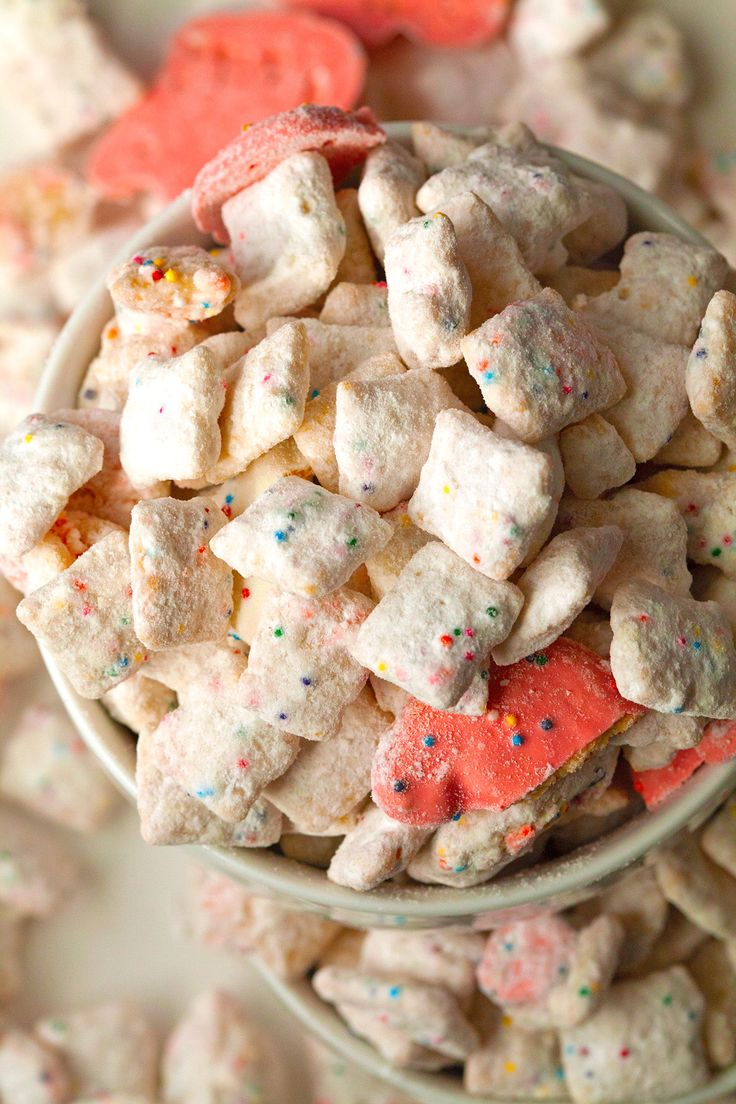 Frosted Animal Cracker Confetti Cake Muddy Buddies | Deliciously Yum!