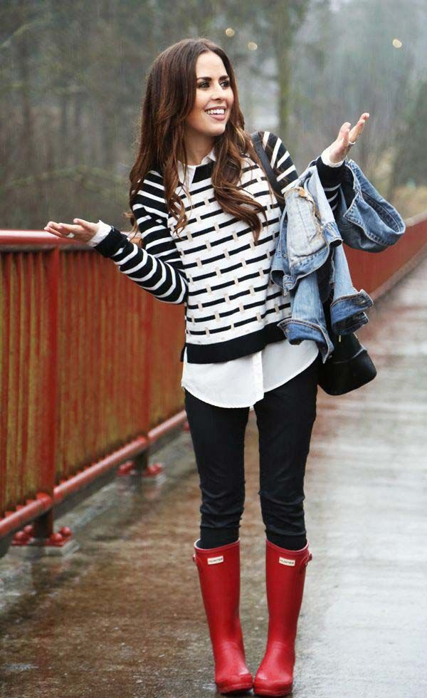 Striped sweater layered look with black jeans and red hunter boots