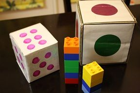 roll the dice then add the number of blocks to your tower, tallest one wins