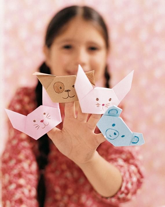 Origami Napkin Finger Puppets  Keep their imaginations alive all summer -- use origami to make paper napkins into furry friends for kids at the dinner table.