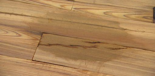 Watch this video for some tips on how to remove stains from wood floors without sanding and refinishing using hydrogen peroxide or floor rejuvenator cleaners.