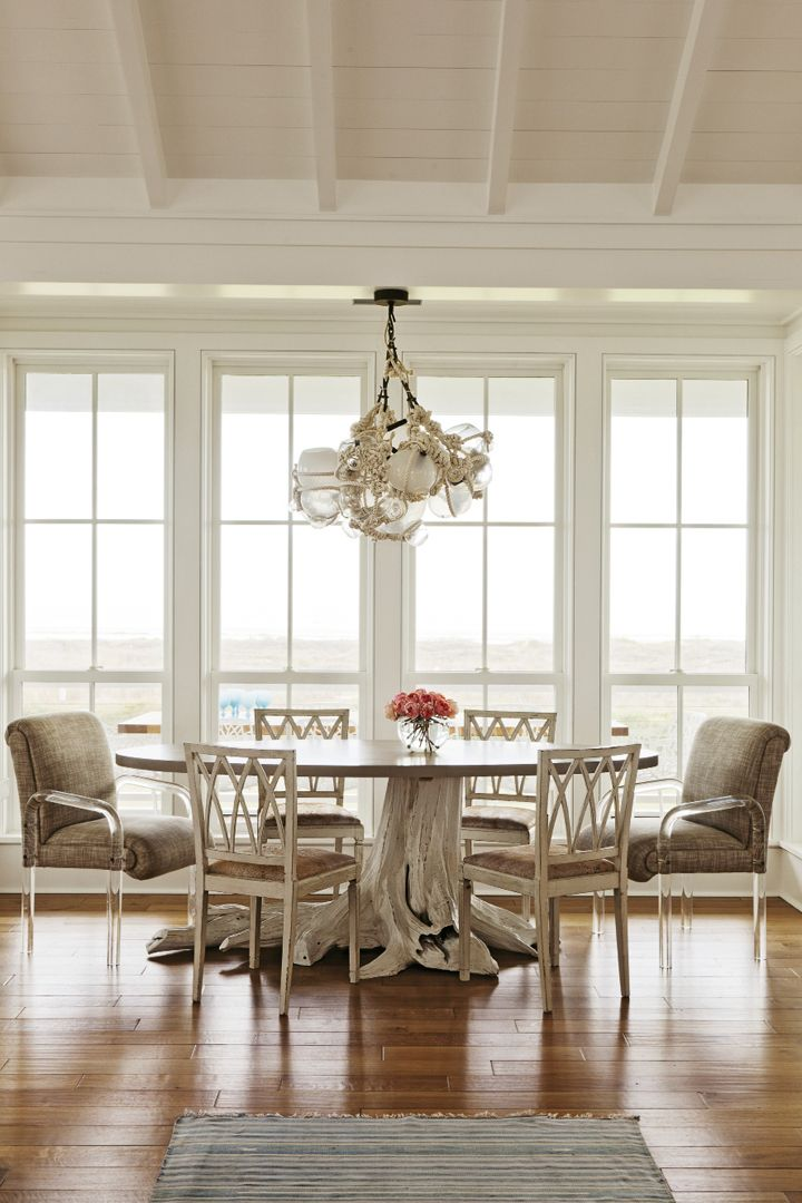 This beautiful Sullivan's Island oceanfront home designed by Jenny Keenan is about as dreamy as they come! The Charleston-based interior designer worked with architect Beau Clowney to create the ca…
