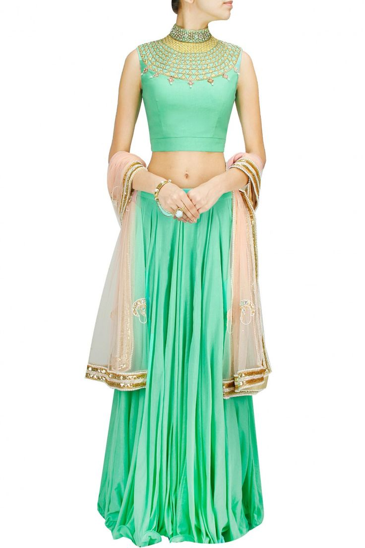 Harshitaa Chatterjee Deshpande   This lehenga set features a green cotton mal flowy lehenga.  It comes along with green cotton choli with zari stone embroidered neck and peach embroidered net dupatta.  FIT: Fits true to size.  COMPOSITION: Cotton mal, net. Lining: Shantoon.