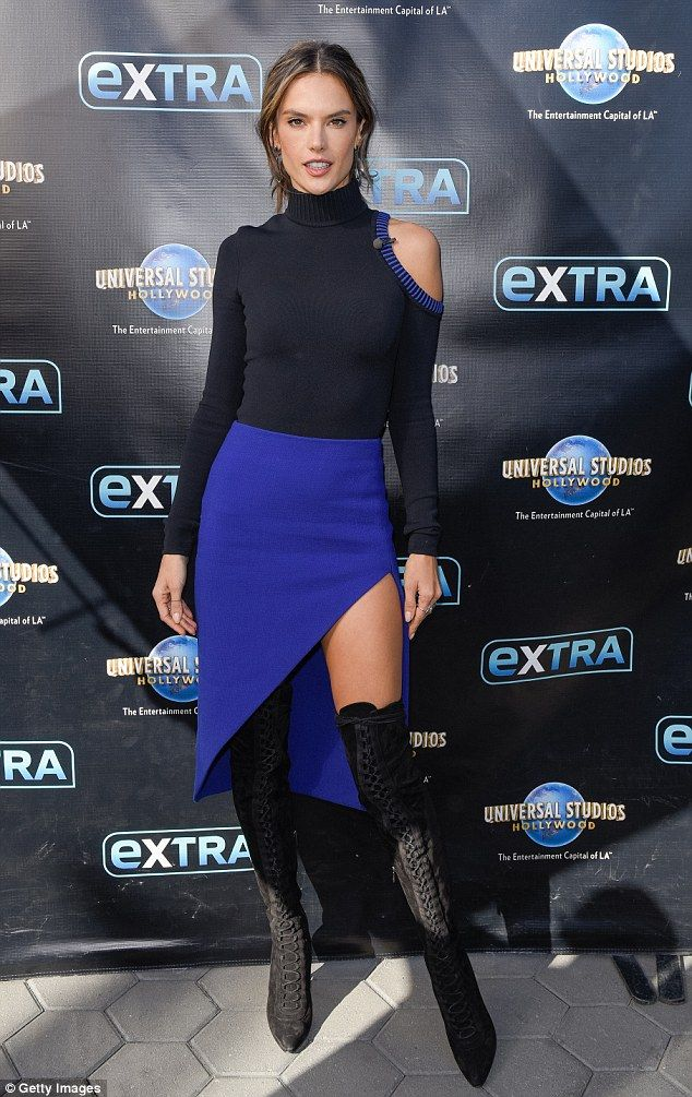 Angel reporting for duty: Alessandra Ambrosio, 35, visited Extra on Friday to promote the ...