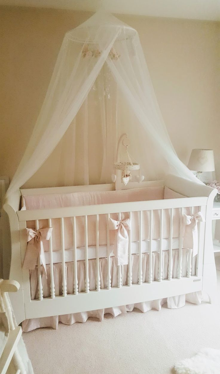 Emilia's crib in her nursery. Pink bumper and skirt from etsy. Canopy from ikea. DIY mobile. More details on blog.
