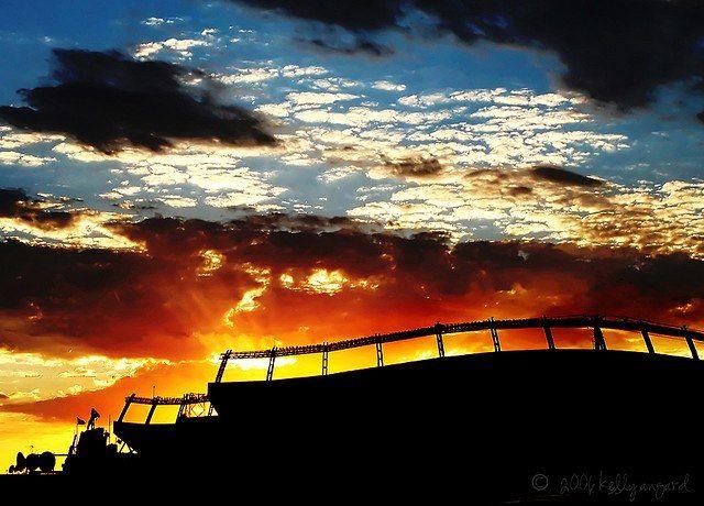 Denver Bronco Sunset behind the Broncos stadium