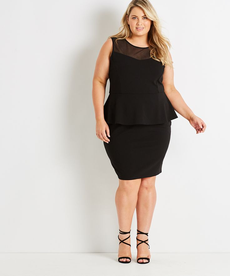 A structured knee-length dress featuring a striking mesh detail at the neckline and finished with a feminine peplum waist. This is a timeless black dress that is both stylish and comfortable.  FEATURES + Body hugging fit with stretch + Mesh insert draws attention upwards + Peplum waist nips in for a flattering silhouette + Invisible back zip + Lined bodice  Studio East has been designed specifically to flatter and fit the plus size figure. Click here to find the perfect fit