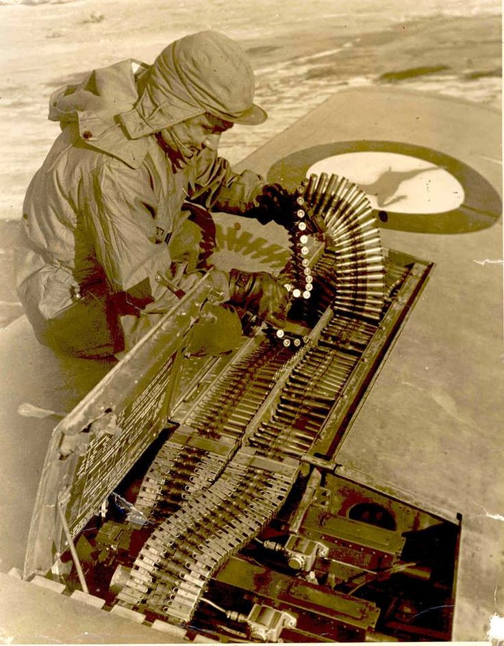 SAAF Armourer hard at work re-arming a 2 Squadron Mustang in Korea, 1952 (748×960)