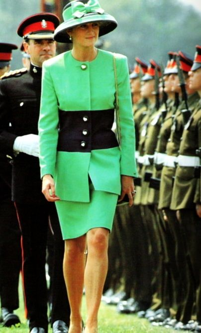 Princess Diana circa 1992... Not sure where (but also wore this green skirt suit and hat at the wedding of Lady Helen Windsor and Tim Taylor holding hands with her son Harry).