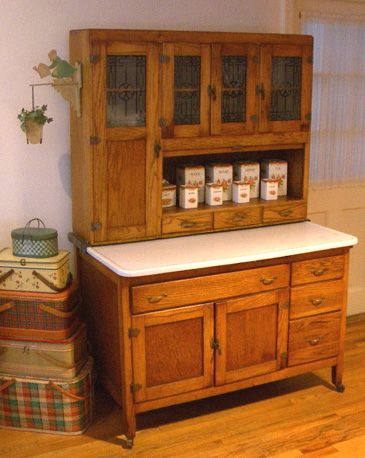 Hoosier cabinet--Earlier cabinets were made from sturdy oak; later versions used lesser grade woods painted to match kitchen color trends of that time. These ingenious cabinets could be purchased from the Sears catalog or other merchants and delivered anywhere within reach of a railroad. The Hoosier cabinet fell out of favor when built-in kitchen cabinets became all the rage in the 1940s.