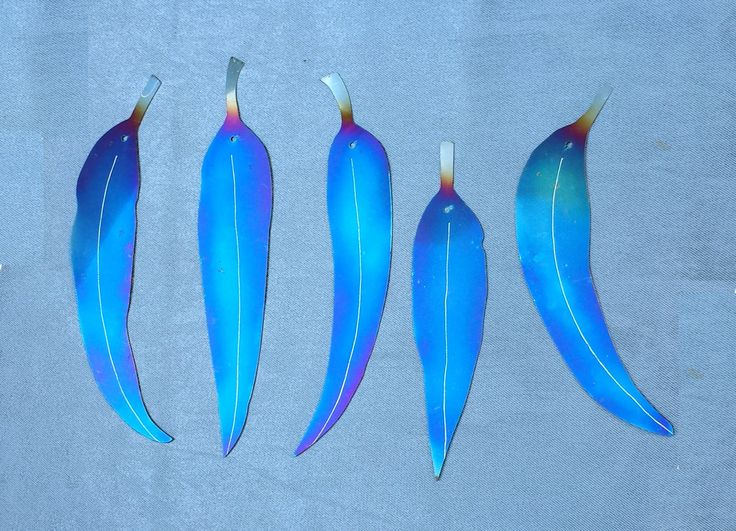 Stainless steel blue coloured decorative eucalypt leaf set by GalaxiaMetal on Etsy