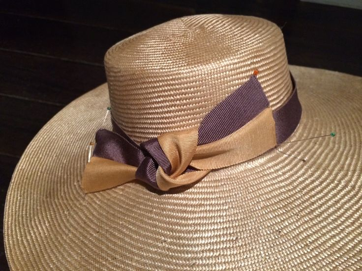Blocked straw, flat top crown and gentle slope brim.  Trim from Harold at Mi Mi Millinery supplies