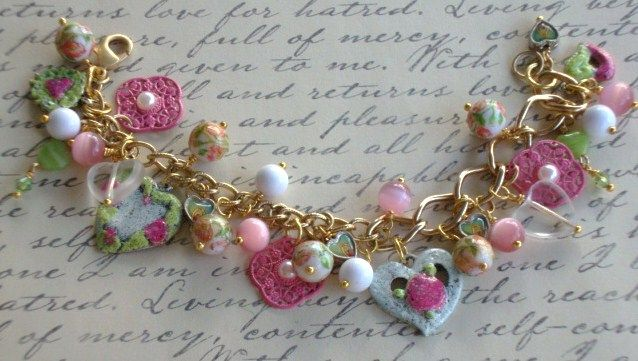 Heart Charm Bracelet .. some hearts are painted using Iced Enamels .. a mixture of glass beads and pink charms .. chain is gold and is 2 different styles .. .. 20% SALE DOES NOT APPLY TO THIS BRACELET .. $45.00