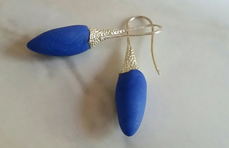 Hand formed bright Blue Pods with silver ball cap earwires. One pair only.