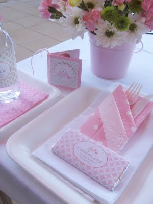 """Folded colored napkin with utensils over white napkin - could easily be made in advance an should make the table """"unchaotic"""""""
