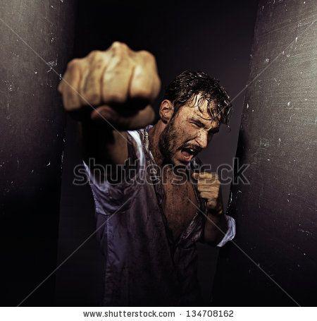 Angry handsome man by conrado, via ShutterStock