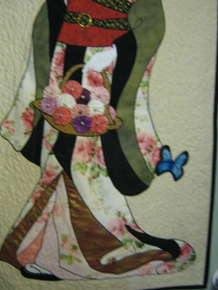 """2013 The butterfly was added due to when I was satin stitching my machine broke down and ripped the fabric so I improvised, ( like you do.) The flowers ar suffolk puffs. 48"""" x 24"""""""