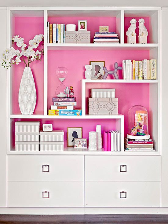 Well-done storage also relies on a variety of pieces in order to mix-and-match practicality with beauty. This full-wall system uses open shelves of various sizes, providing a built-in mechanism for displaying a range of pieces and storing some essentials, too. Drawers disguise files behind pretty pulls and fronts.