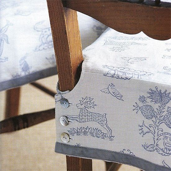 DIY chair covers. Love the buttons! Don't like this fabric but love the idea of removable, washable covers that can be changed by season/holiday.