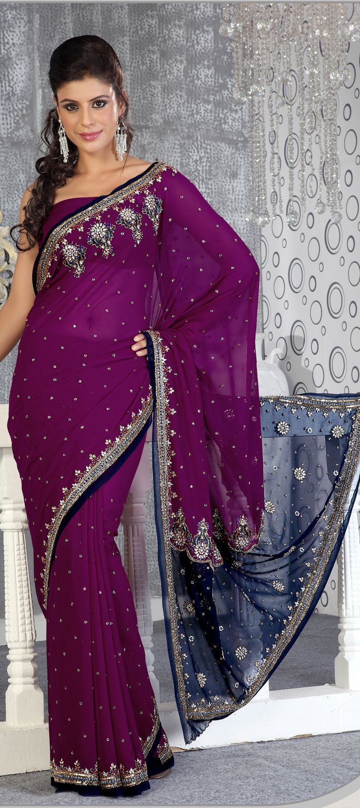 81121: Purple and Violet color family Saree with matching unstitched blouse.