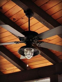 exposed log beam pitched with drop ceiling ceiling fans and recessed lights - Google Search