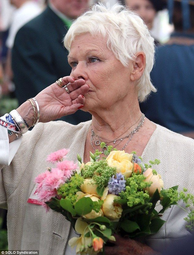 Dame Judi's new ink can be seen on the inside of her wrist, after she got a 'Carpe Diem' as part of an 81st birthday present from her daughter