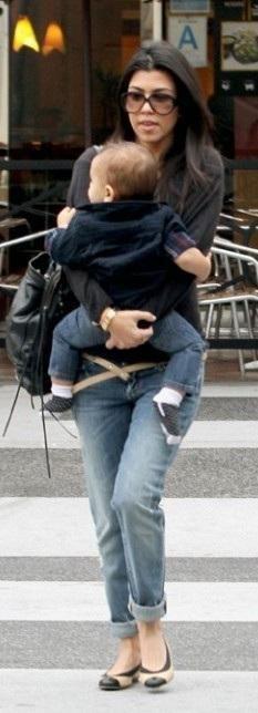 Who made Kourtney Kardashian's black sweater, ballet flats, jeans, black purse and belt that she wore in Los Angeles? Sweater – Prada  Shoes – Chanel  Jeans – Paige  Purse – Balenciaga  Belt – Kieselstein-Cord
