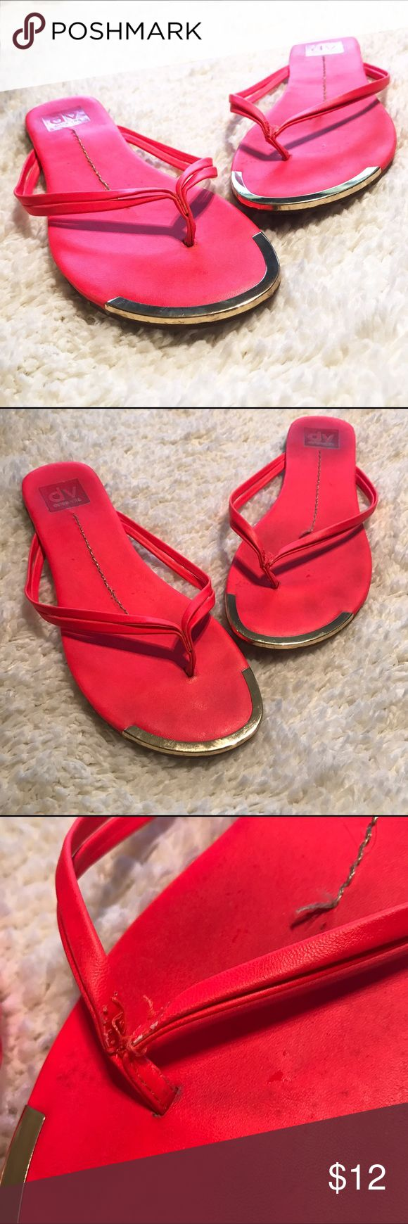 Dolce Vita Flip Flops with Gold Tip Red flip flops by Dolce Vita worn medal gold tips. Well loved but the foot beds and soles just have marks from wear, not actually scratches or anything. One of the toe separators is split as shown, I think it could easily be glued or can be worn as is. Feel free to ask any questions. Dolce Vita Shoes Sandals
