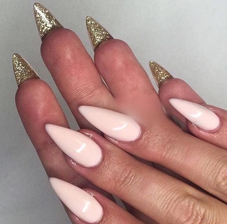 Pastel pink with glitter gold stiletto nails