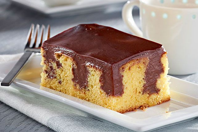 The easiest, most delicious way to dress up a yellow cake made from a mix? Poke holes in the top and fill them with luscious, chocolatey pudding.