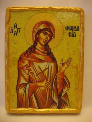 http://religmuseum.com/imgs/a/b/o/m/c/st_theodosia_rare_greek_eastern_orthodox_icon_art_on_aged_pine_wood_plaque_1_thumb2_lgw.jpg