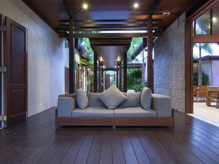 Niramaya - Port Douglas.  This is so much like my fav part of my last house.  They are using different flooring to mark the transition of inside and out.  I think I would like it all the same? (Grey Ironbark).