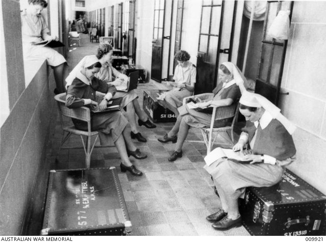 Australian nurses writing letters home in the comfortable quarters of one of the Australian general hospital units. 1941. #Letter