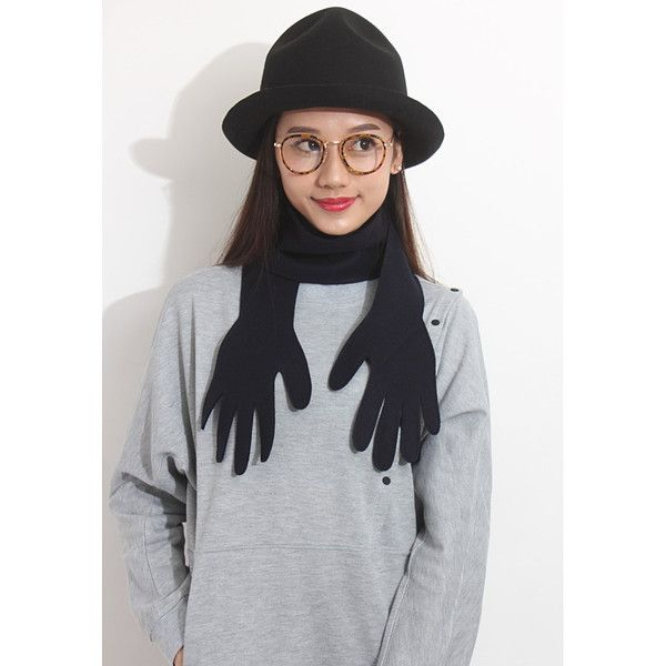 Have a little fun this fall and winter wearing this Playful Palm Wooly Scarf in Navy. One Size Fits All. Composition: Wool Polyester.
