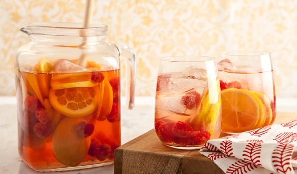 White Sangria with Raspberries.  I think it's time for another drink.  If raspberries are not in season then add what is~like strawberries.  Tasty!!  click on the picture for the recipe.