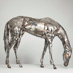 Stainless steel horse made from cutlery. www.livingart.global