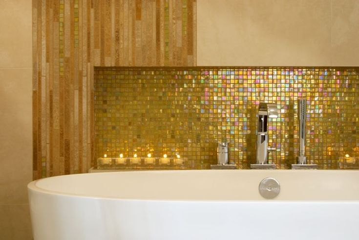 Our homeowners expressed a desire to change their  early 90's inspired, pink bathroom to a more modern spa-like